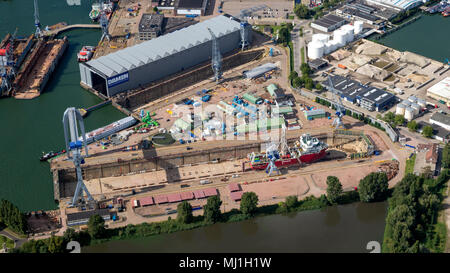 ROTTERDAM, THE NETHERLANDS - SEP 2, 2017: Aerial view of a ship in a repair dry dock in the industrial port of Rotterdam. - Stock Photo