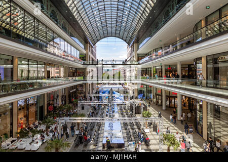 BERLIN, GERMANY - APRIL 28, 2018: Interior view of the new Mall of Berlin shopping centre at Leipziger Platz. The mall has various shopping facilities - Stock Photo