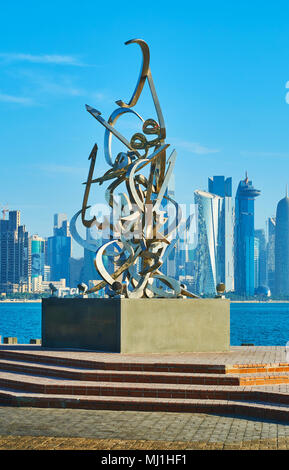 DOHA, QATAR - FEBRUARY 13, 2018: The Corniche promenade is decorated with Calligraphy sculpture of Sabah Arbilli, based on poem of the founder of Qata - Stock Photo