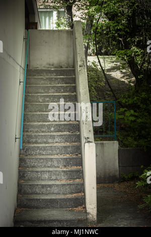 Old abandoned stairs at a house parking space - Stock Photo