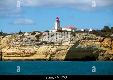 Lighthouse Alfanzina, rocky coast, Carvoeiro, Algarve, Portugal - Stock Photo