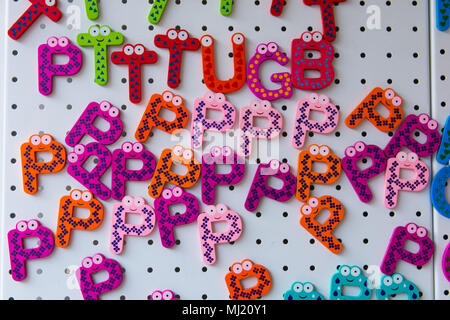 ornamental magnets made up of cute letters. colored letters - Stock Photo