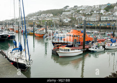 A variety of fishing, boats, yachts and pleasure craft moored in Newlyn Harbour with the town of newlyn in the background. - Stock Photo