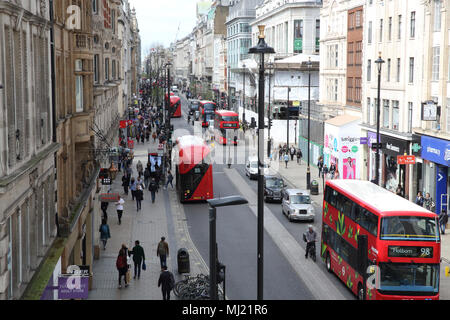 Buses and other traffic on Oxford Street at east end near Tottenham Court Road, in London, UK. - Stock Photo