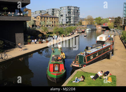 Barges on Regents Canal by Granary Square at Kings Cross, in London, UK - Stock Photo
