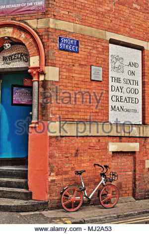 A Bike And Go Bike Leaning Against The Wall Of The Iconic Afflecks Palace Emporium In Manchester City Centre England May 2018 - Stock Photo