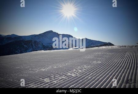Sunny piste in ski resort - Stock Photo