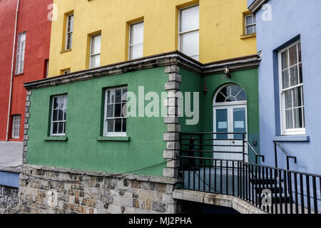 Detail view of colourful south facade houses of Dublin Castle court yard, against the grey Norman stone. Dublin, Republic of Ireland, Europe. - Stock Photo