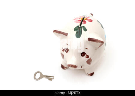 Floral Piggy Bank Money Box with Key - Stock Photo