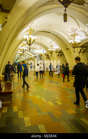 MOSCOW, RUSSIA- APRIL, 29, 2018: Unidentified people walking inside of Beautifully decorated metro station Arbatskaya, in Moscow - Stock Photo