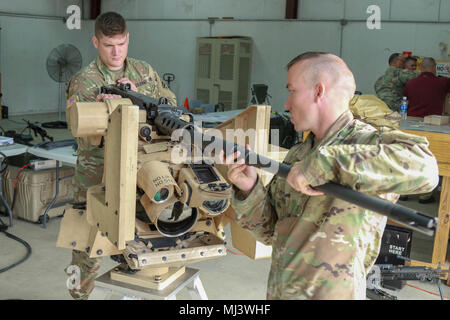 Fort Stewart, Ga., March 20, 2018 - Georgia Army National Guardsmen Staff Sgt. Christopher Robinson, Bravo Company, 3rd Battalion, 121st Infantry, Atlanta, Ga., and Sgt. Bradley Sherman, Charlie Company, 12nd Battalion, 12st Infantry , Cordele, Ga., install the barrell of a CROWS mounted M2A2 .50 caliber machine gun during the Instructor's training course. Upon completion of the course, the new instructors will teach Georgia National Guardsmen new tactics, techniques and procedures to utilize the system effectively.  (Georgia Army National Guard Image collection celebrating the bravery dedicat