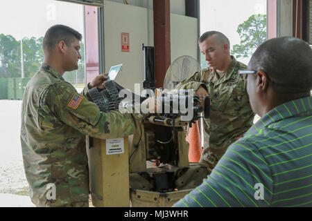 Fort Stewart, Ga., March 20, 2018 - Georgia Army National Guardsmen Staff Sgt. Christopher Robinson, Bravo Company, 3rd Battalion, 121st Infantry, Atlanta, Ga., and Sgt. Bradley Sherman, Charlie Company, 12nd Battalion, 12st Infantry , Cordele, Ga., perform pre-system checks on the CROWS weapon system to ensure porper operation.  The Common Remotely Operated Weapon Station is an externally mounted weapons control system that allows the gunner to remain inside the vehicle while firing various crew served Weapons.  (Georgia Army National Guard Image collection celebrating the bravery dedication
