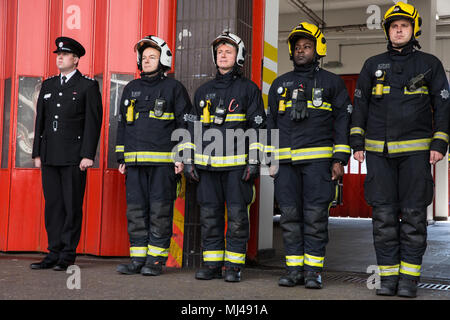 London, UK. 4th May, 2018. London Fire Brigade firefighters honour the bravery and sacrifice of colleagues who lost their lives in the course of their fire and rescue duties with a minute's silence outside Soho Fire Station on Firefighters' Memorial Day. Credit: Mark Kerrison/Alamy Live News - Stock Photo