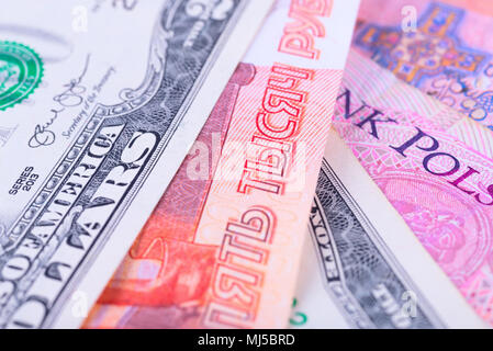 The background from the money of different countries: dollars, euros and Russian rubles. - Stock Photo