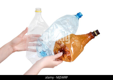 Female hands holding different types of crushed plastic bottles isolated on white. Recyclable waste. Recycling, reuse, garbage disposal, resources, environment and ecology concept