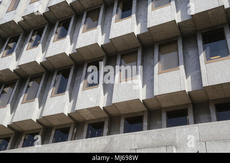 Section of a modern building in Leeds City Centre West Yorkshire. The architect designed a repeating pattern of glass and concrete of​ geometric lines - Stock Photo