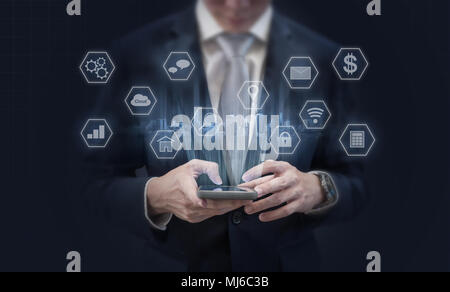 Businessman using mobile smart phone and application icons. Mobile application, social media and e-commerce technology - Stock Photo