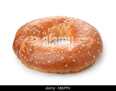 Fresh baked bagel isolated on white background - Stock Photo