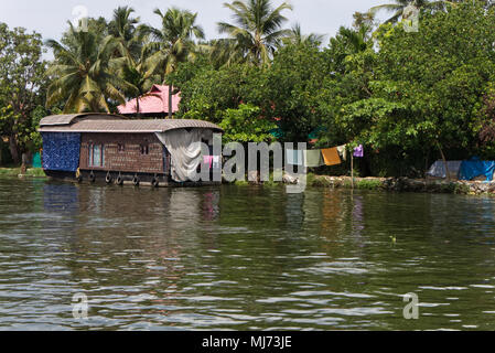 Alappuzha, Kerala / India - April 15 2018 : A tourist house boat is docked to one of the banks of the Alappuzha waterways. - Stock Photo