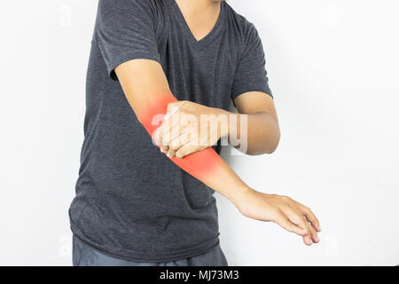 Man has arm pain and ache on white background - Stock Photo