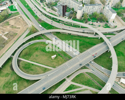 Aerial highway junction. Highway from aerial view. Urban highway and lifestyle concept. Construction of additional concrete road curve of viaduct in R - Stock Photo