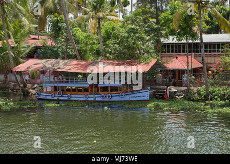 Alappuzha, Kerala / India - April 15 2018: A traditional house boat is carrying tourists on the waterways of Alappuzha. - Stock Photo