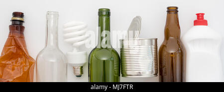 Recyclable waste, resources. Clean glass, paper, plastic and metal on white background. Recycling, reuse, garbage disposal, resources, environment and ecology concept - Stock Photo