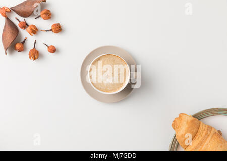coffee with flowers and croisssant - Stock Photo