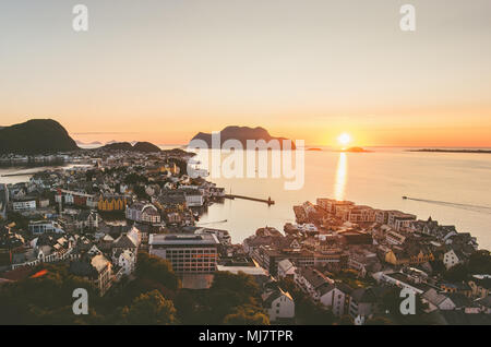 Alesund city in Norway sunset over ocean aerial view - Stock Photo