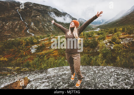 Happy woman traveler raised hands walking in forest mountains Travel adventure healthy lifestyle concept vacations - Stock Photo