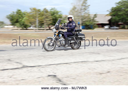 Cuban police officer on motorcycle rides along the highway between Havana and Trinidad. - Stock Photo