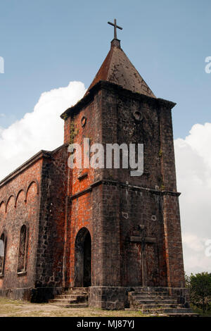 Bokor Hill Station Cambodia, view of abandoned colonel french catholic church - Stock Photo