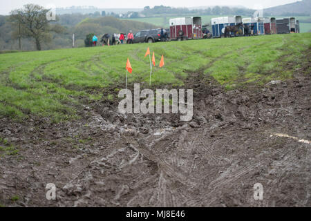 horse boxes in muddy field - Stock Photo