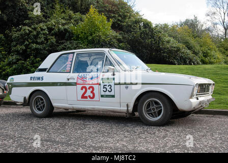 1967 White Ford Lotus Cortina Mk II Sports Saloon Car front offside right hand drivers side view of 1967 white with green stripe ford lotus cortina ma - Stock Photo