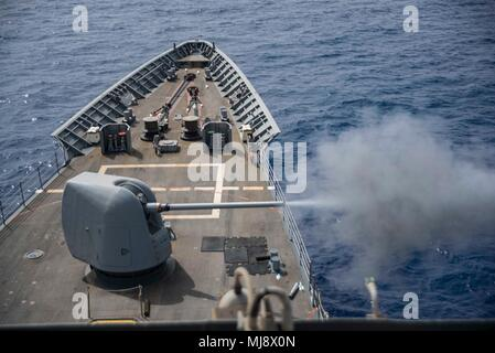 180419-N-DO281-0119  MEDITERRANEAN SEA (April 19, 2018) The guided-missile cruiser USS Monterey (CG 61) fires it's 5-inch gun during a live-fire exercise. Monterey, homeported in Norfolk, Va., and is conducting operations in the U.S. 6th Fleet area of operations in support of U.S. national security interest in Europe. (U.S. Navy photo by Mass Communication Specialist Seaman Trey Fowler/Released) - Stock Photo