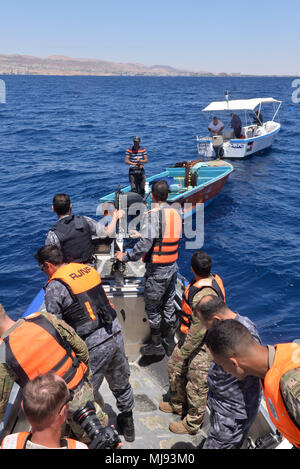 AQABA, Jordan (April 23, 2018) --  Members of U.S. Army Civil Affairs and Royal Jordanian Navy Combat Boats Group approach two Jordanian fishing boats to give out medical supply kits in a civilian outreach event during Eager Lion, April 23, 2018.  Eager Lion is a capstone training engagement that provides U.S. forces and the Jordan Armed Forces an opportunity to rehearse operating in a coalition environment and to pursue new ways to collectively address threats to regional security and improve overall maritime security.  (U.S. Navy photo by Mass Communication Specialist 1st Class Sandi Grimnes - Stock Photo