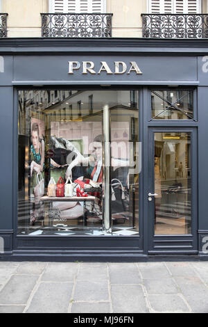 PARIS - JULY 24: Prada store on July 24, 2011 in Paris, France. The Italian fashion company is present in 65 countries with 250 single brand shops. It - Stock Photo