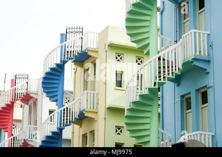 colorful spiral staircases at the back of traditional chinese shop houses in singapore city - Stock Photo