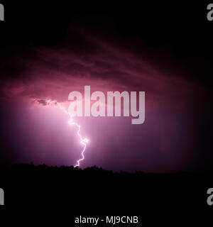 Frequent lighting comes with summer monsoon storms in Arizona, USA. - Stock Photo