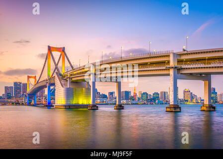 Tokyo, Japan at Rainbow Bridge spanning the bay at twilight. - Stock Photo