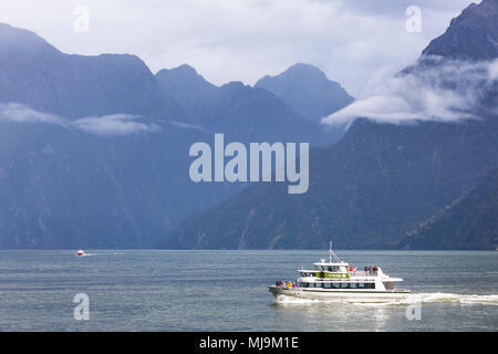 Milford sound New Zealand Milford sound boat trip on milford sound tourists returning to the cruise terminal milford sound new zealand South Island nz - Stock Photo