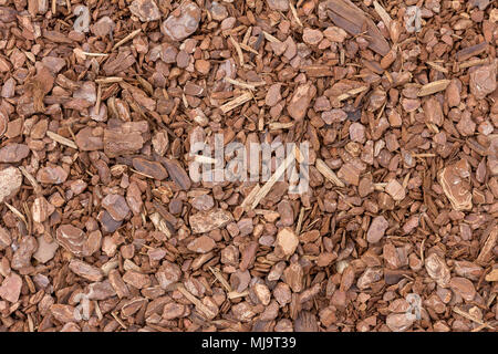 A background image of wood chip used for safety in toddlers playgrounds - Stock Photo