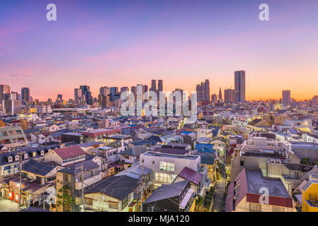 West Shinjuku, Tokyo, Japan financial district cityscape over residential neighborhoods at dusk. - Stock Photo