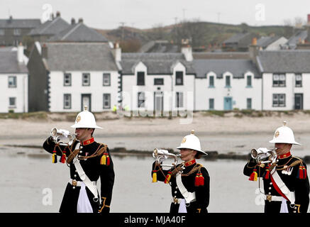 Bugler players from the Royal Marines during a commemoration service at the War Memorial in Port Ellen, Islay, for around 700 First World War soldiers who lost their lives following the sinking of the SS Tuscania and HMS Otranto within eight months of each other in 1918 off of the coast of the small Scottish island. - Stock Photo