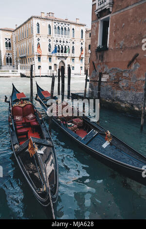 Two gondolas parked on Grand Canal. Venice, Italy. - Stock Photo