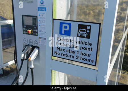 Electric car charging point in a rural location inside a shelter - Stock Photo