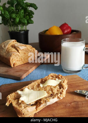 a slice of bread and butter, self-made, super fluffy and tasty - Stock Photo