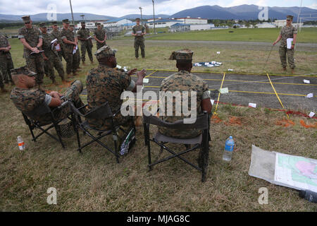 U.S. Marines with 3rd Battalion, 12th Marine Regiment, 3rd Marine Division brief 3rd Battalion Commanding Officer Lt. Col. Leroy B. Butler about operations for the following day during Artillery Relocation Training Program 18-1 April 26, 2018, on Combined Arms Training Complex, Camp Fuji, Japan. ARTP 18-1 is a Japan-funded, routine training exercise that allows Marines with the battalion based out of Camp Hansen, Okinawa, Japan, to conduct live-fire training in Japan. The Okinawa-based battalion is the only forward-deployed artillery battalion in the Marine Corps since 1956. (U.S. Marine Corps - Stock Photo