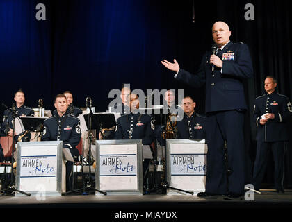 Col. Roman Hund, installation commander, welcomes the U.S. Air Force Band Airmen of Note to the area during a performance in Gloucester, Mass., April 23. The performance was part of the band's spring concert series in New England. Airmen of Note is based at Joint Base Anacostia Bolling in Washington, D.C. (U.S. Air Force photo by Linda LaBonte Britt) - Stock Photo