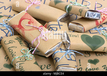 background from the color decorated chocolates on Kraft to paper - Stock Photo